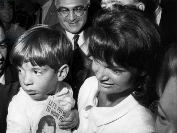 John F. Kennedy Jr., and Jacqueline Kennedy, at Robert Kennedy's political headquarters in New York. September 15, 1964