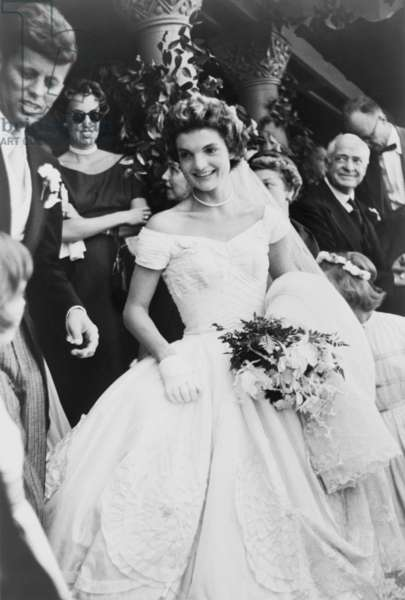 Jacqueline Bouvier Kennedy emerging from St. Mary's church in Newport Rhode, Island, on her wedding day. At far left is Senator Jack Kennedy. September 12, 1953 photo by Toni Frissell