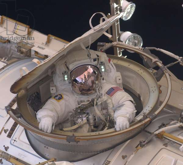 International Space Station in 2011. Astronaut Andrew Feustel reenters the space station after completing an 8-hour spacewalk on May 22, 2011