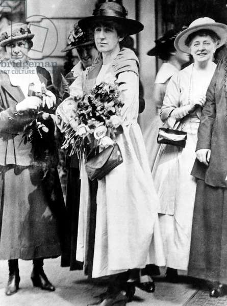 First female member of the U.S. House of Representatives, Jeannette Rankin (center), being honored by members of the suffragette movement, Washington D.C., c. 1910's.