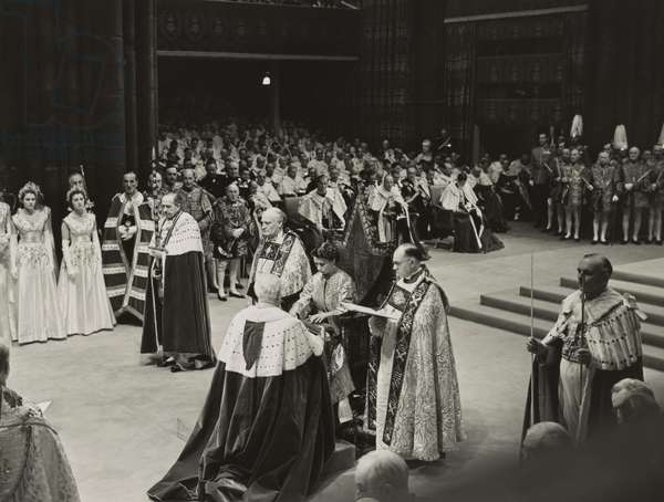 Coronation ceremony of Queen Elizabeth II, June 2, 1953. She is receiving the Spurs of Chivalry from the Lord Great Chamberlain.