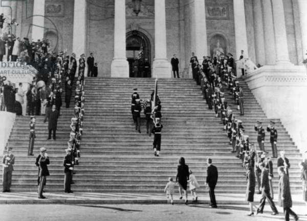Jacqueline Kennedy escorts her children, Caroline and John, Jr. up the steps of the Capitol. They are following the casket of assassinated President John Kennedy. Other members of the Kennedy family, led by Robert Kennedy are behind. Nov. 24, 1963