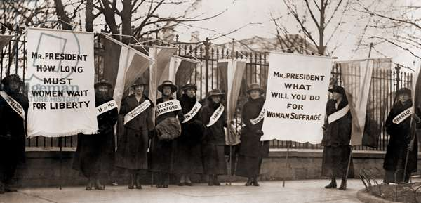 National Women's Party demonstration by college women in front of the White House in 1918. The banner protests Wilson's failure to support women's suffrage