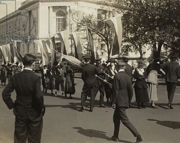 Police confront a line of National Woman's Party pickets and seize their banners on Constitution Avenue, outside Senate Office Building in October 1918