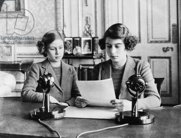 British Royal Family. Future Countess of Snowdon Princess Margaret and Future Queen of England Princess Elizabeth, preparing for a radio address, c.early 1940s