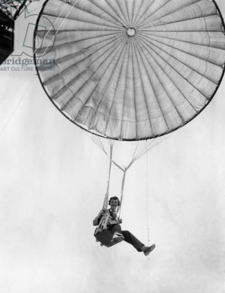 Amelia Earhart helps test a commercial parachute. June 2, 1935.