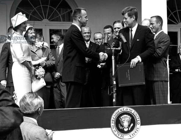 President John F. Kennedy presents astronaut Alan B. Shepard, Jr., the first American in space, with the NASA Distinguished Service Award. May 8, 1961