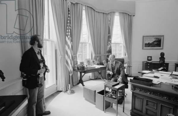 President Gerald Ford chatting with Pulitzer Prize winning photographer David Hume Kennerly who documented the Ford Presidency. Feb. 6 1975