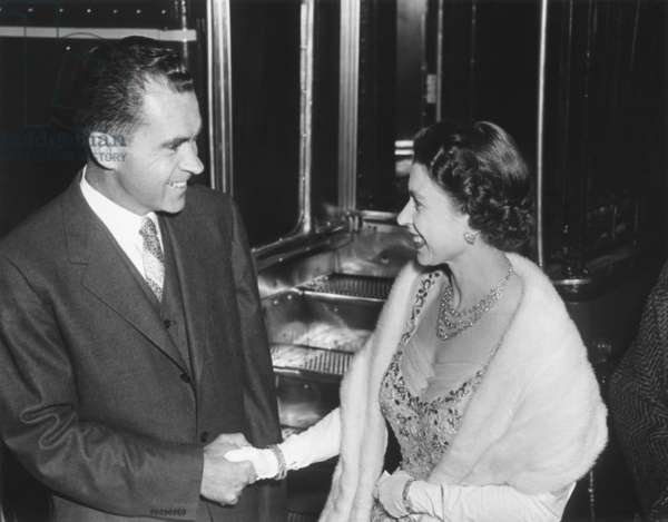 Queen Elizabeth II shaking Vice President Richard Nixon's hand. At the British Embassy in Washington during a dinner the royal couple gave for President and Mrs. Eisenhower. Oct. 19, 1957.