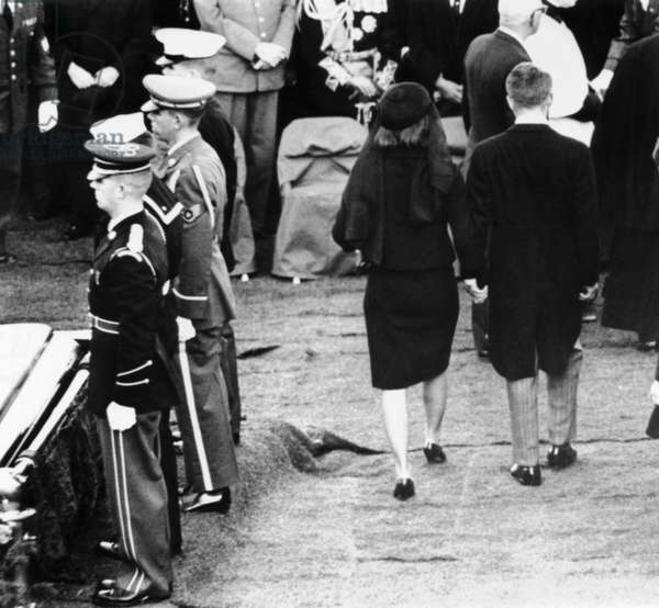 Jacqueline Kennedy and Robert Kennedy leave the grave site at the end of President John Kennedy's funeral. Nov. 25, 1963