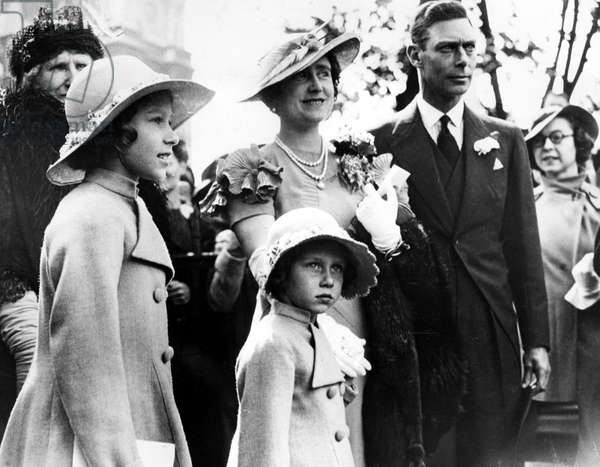 The soon to be Royal Family in 1936, prior to King Edward's abdication of the throne. Princess Elizabeth (left), the Duchess of York (soon to be Queen Elizabeth, and later, the Queen Mother), The Duke of York (soon to be King George VI), Princess Margaret (front).