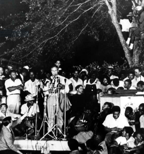Marlon Brando speaks to civil rights marchers in Tougaloo, Mississippi. Martin Luther King Jr. (left) looks on, 1966