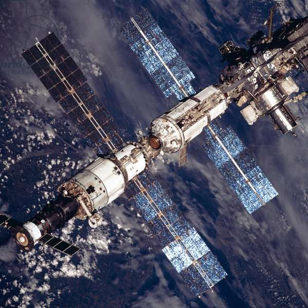 International Space Station in 2001. Overhead close-up view of the expanded International Space Station. At lower left a Russian Soyuz capsule is docked