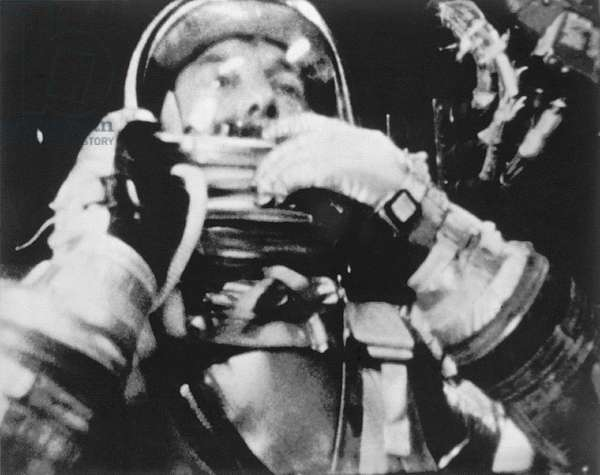 Astronaut Alan Shepard inside the Freedom 7 spacecraft during his historic fifteen and a half minute flight on May 5, 1961. Shepard is about to raise the shield in front of his face during descent