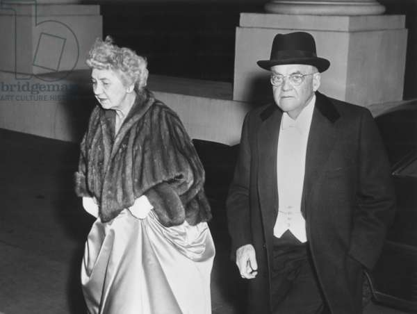 Sec. of State John Foster Dulles and his wife, arriving at state dinner for Queen Elizabeth II. Oct 17, 1957.