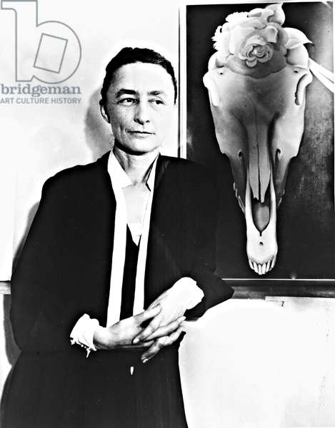 Georgia O'Keeffe and one of her skull paintings, 1931.