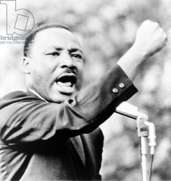 Martin Luther King, Jr., gesturing with right fist while delivering speech at Girard College, Philadelphia, on Aug. 3 1965