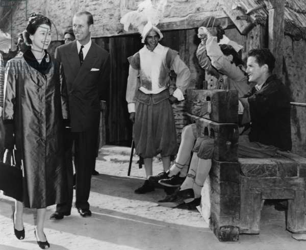 Queen Elizabeth II and Prince Philip are amused by two 'prisoners' in stocks at Jamestown. The Royal couple visited Virginia during the 350th anniversary celebration of the founding of Jamestown. Oct. 16, 1957