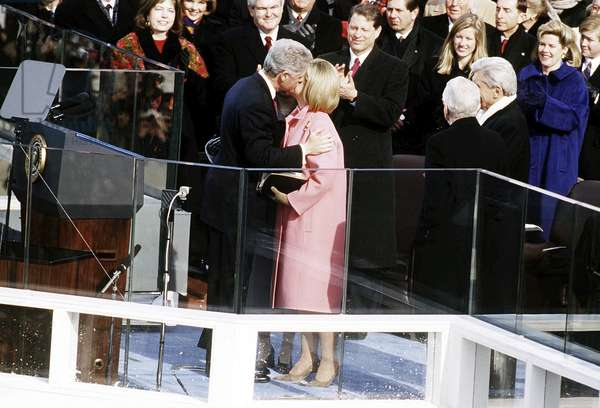 CLINTON INAUGURATION, 1997 President Bill Clinton and First Lady Hillary Clinton kissing following Bill Clinton's second inaugural ceremony. Photograph, 20 January 1997.