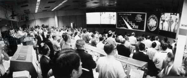 APOLLO 13: MISSION CONTROL View of the Mission Control Room at the Manned Spacecraft Center during post-recovery ceremonies for the rescued Apollo 13 crew. Photograph, 1970.