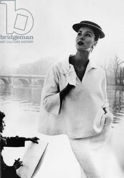 SUZY PARKER (1932-2003) Née Cecilia Ann Renee Parker. American model and actress. Wearing fashions by Balenciaga along the Seine in Paris, France, c.1953. Photographed by Louise Dahl-Wolfe.