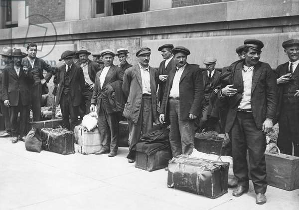IMMIGRANTS: ELLIS ISLAND A group of Italian immigrant men preparing to leave Ellis Island, c.1900.