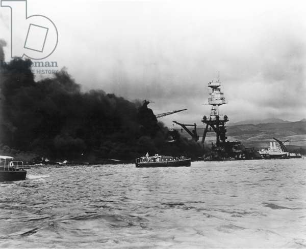 WWII: PEARL HARBOR, 1941 Pearl Harbor, Hawaii, December 7, 1941. The USS Arizona at the height of the fire.