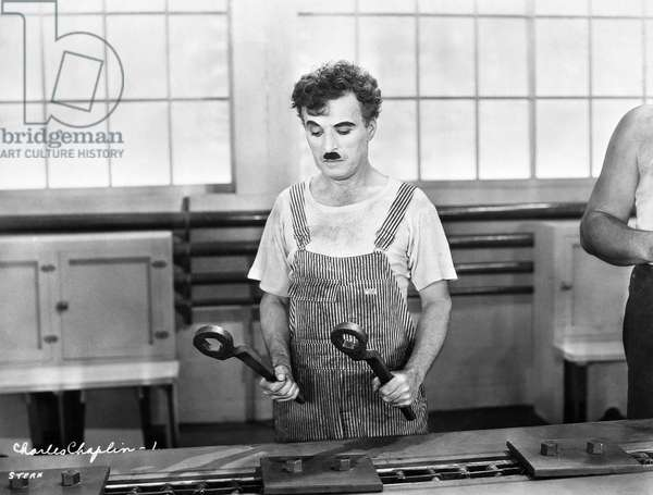 CHAPLIN: MODERN TIMES, 1936 Charlie Chaplin in a scene from the film 'Modern Times', 1936.