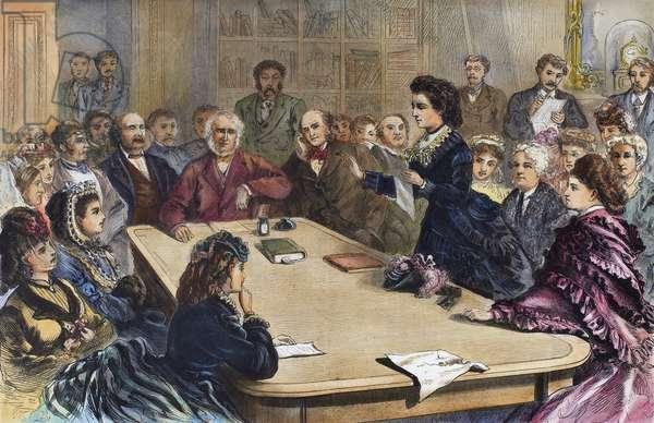 VICTORIA CLAFLIN WOODHULL (1838-1927). American reformer. Victoria Claflin Woodhull reading her argument in favor of women's suffrage before the Judiciary Committee of the House of Representatives in 1871. Directly behind Mrs. Woodhull is Elizabeth Cady Stanton and at the extreme left is Susan B. Anthony.