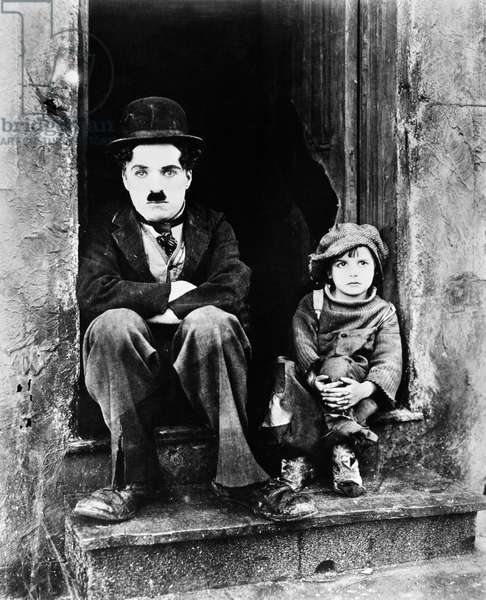 CHAPLIN: THE KID, 1921 Charlie Chaplin and Jackie Coogan as his adopted son in Chaplin's film 'The Kid,' 1921.