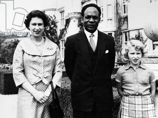 ELIZABETH II (1926- ) Queen Elizabeth of England, photographed with Prime Minister Kwame Nkrumah of Ghana and Princess Anne, at Balmoral Castle in Scotland, August 1959.