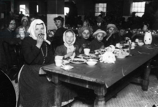 ELLIS ISLAND, 1920 Lunch time at Ellis Island, on the second floor, 1920.