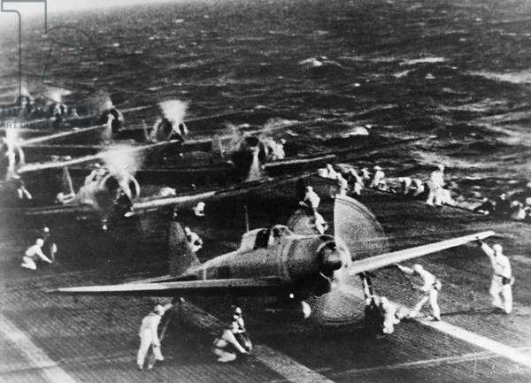 WORLD WAR II: PEARL HARBOR Japanese planes preparing to take off from an aircraft carrier, before attacking on Pearl Harbor, Hawaii, December 1941.