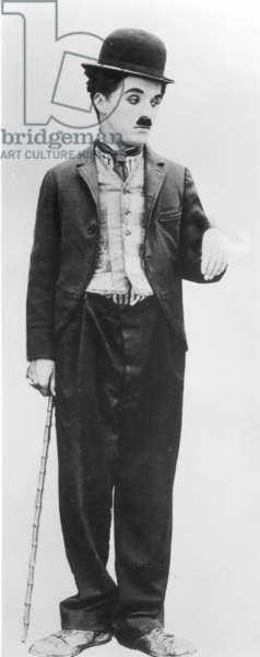 CHARLIE CHAPLIN (1889-1977) English actor and comedian. In the role of the Little Tramp.