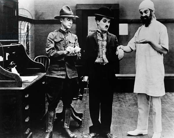 CHAPLIN: SHOULDER ARMS Charlie Chaplin, center, undergoing a medical examination in his World War I film 'Shoulder Arms,' 1918.