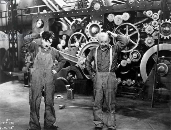 CHARLIE CHAPLIN and Andy Clyde in a scene from