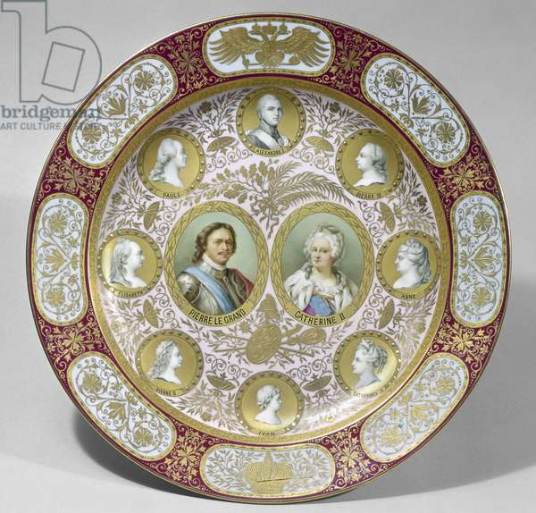 RUSSIA: ROMANOVS Peter the Great and Catherine II are featured at the center of a gold and enamel plate with portraits of members of the Romanov imperial family, 19th century.