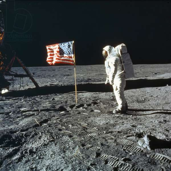 APOLLO 11: BUZZ ALDRIN, 1969 Astronaut Edwin 'Buzz' Aldrin on the moon next to the American Flag. Photographed by Neil Armstrong, 20 July 1969.