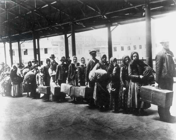 IMMIGRANTS: ELLIS ISLAND Immigrants arriving at Ellis Island, c.1900.
