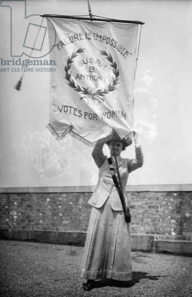 SUFFRAGIST, c.1912 American suffragist Florence Jaffray 'Daisy' Harriman (1870-1967) holding a banner bearing the words of Susan B. Anthony, 'Failure Is Impossible.' Photographed c.1912.