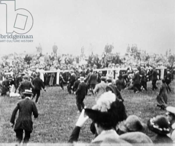 WOMEN'S RIGHTS: DERBY 1913 Crowd rushing onto the scene at the Epsom Derby moments after militant suffragette Emily Wilding Davison threw herself before the King's horse, 4 June 1913. Miss Davison, who later died and jockey Herbert Jones, who sustained minor injuries, lie on the track.