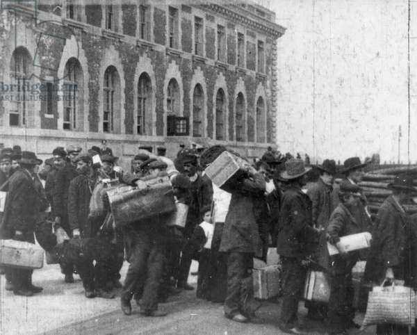 ELLIS ISLAND, c.1895 Immigrants arriving at Ellis Island.