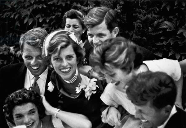 KENNEDY WEDDING, 1953 The Kennedy family surrounding John (lower right) and Jacqueline (lower left) on their wedding day, 12 September 1953. Photograph by Toni Frissell.