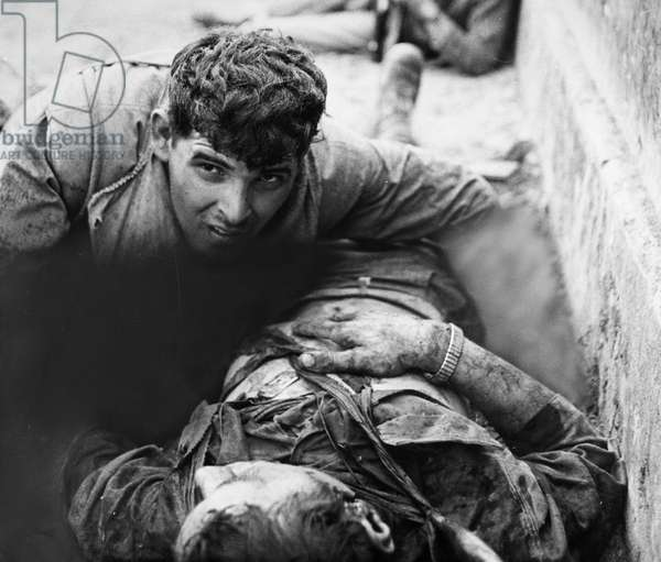 VIETNAM WAR: DYING SOLDIER A U.S. Marine tries to comfort a dying friend at the Citadel wall in Hue, South Vietnam, during the Tet Offensive, February 1968.