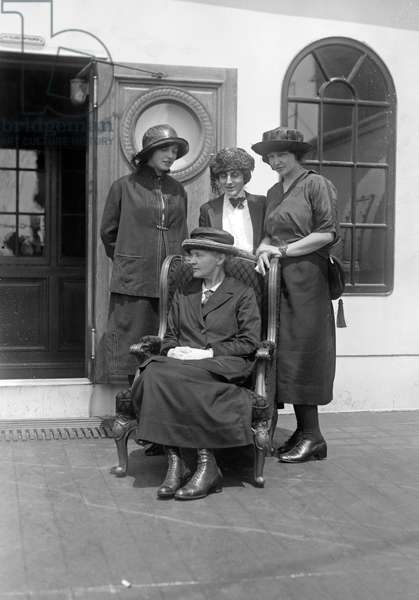 CURIES AND MELONEY, 1921 French chemist Marie Curie (seated) with her daughters Eve and Irene Curie, and journalist Marie Mattingly Meloney aboard a ship in New York Harbor. Photograph, 1921.