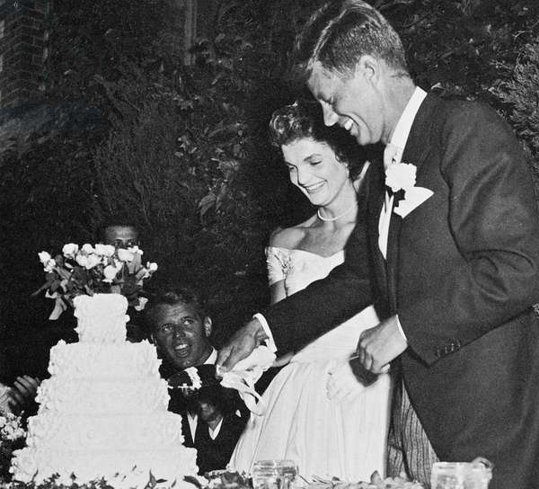 JOHN F. KENNEDY (1917-1963) 35th President of the United States. Photographed with his wife, Jacqueline Bouvier Kennedy, on the day of their wedding, 12 September 1953. Brother Robert F. Kennedy is seated at left.