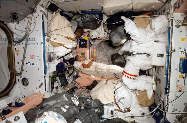 SPACE STATION, 2007 American astronaut Daniel Tani sleeping in the Unity node of the International Space Station. Photograph, 2 November 2007.