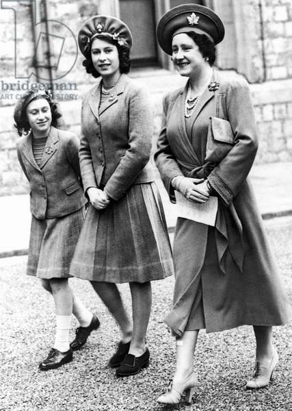 QUEEN ELIZABETH II (1926- ) Queen of Great Britain, 1952- . Princess Elizabeth (center), the future Queen, photographed at Windsor Castle on her 16th birthday in 1942 with her sister, Princess Margaret, and their mother, Queen Elizabeth.
