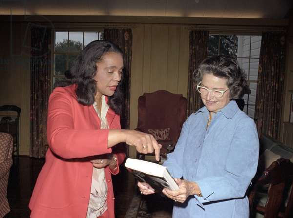 CORETTA SCOTT KING (1927-2006). American civil rights leader; wife of Martin Luther King, Jr. Presenting her book 'My Life with Martin Luther King, Jr.' to Lady Bird Johnson. Photograph by Frank Wolfe, 1979.