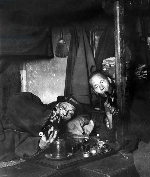 CHINATOWN: OPIUM, c.1909 Two men smoking in an opium den in Chinatown, San Francisco. Photographed c.1909.